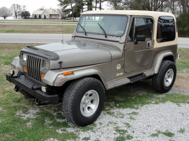 Grey Jeep Wrangler YJ
